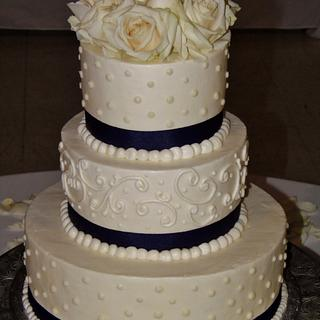 White and navy wedding cake buttercream