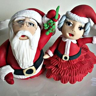 Santa and Mrs. Claus under the mistletoe