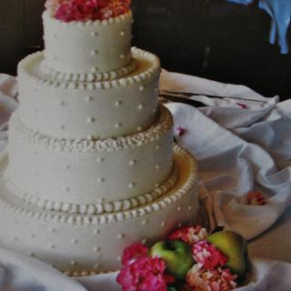 Buttercream pink and green wedding cake