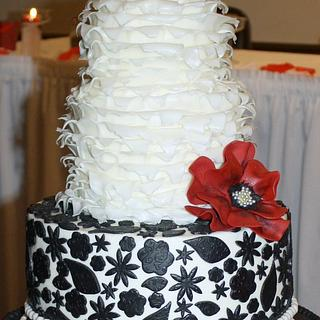 Wedding cake in black, ivory, and red.