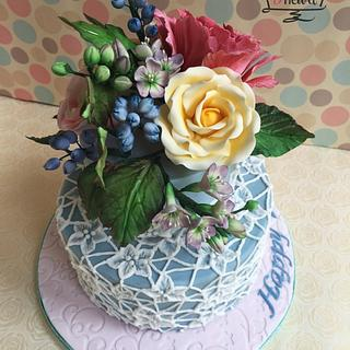 Sugar flowers and brush embroidery lace cake