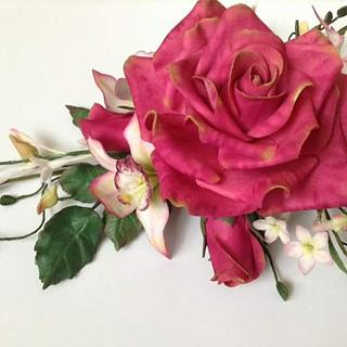 Roses,jasmine,pearl succulents,cymbiduim orchid and foliage.