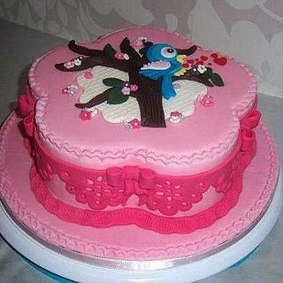 Pink cake with tree and bird