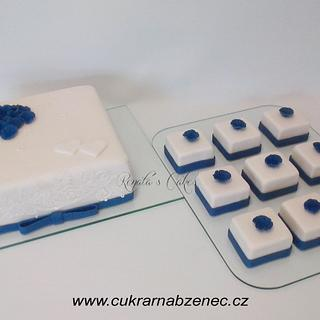 White and blue wedding cake and mini cakes