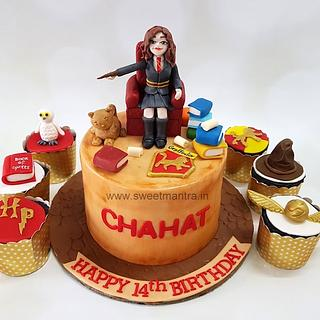 Harry Potter theme cake with 3D hermoine figurine for daughter's birthday