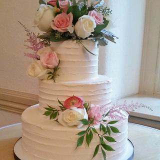 Horizontally textured buttercream wedding cake
