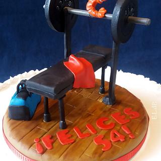 cake topper to an weight lifter