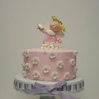 Blossom cake with an Angel topper