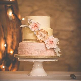 Buttercream and pink ruffle wedding cake