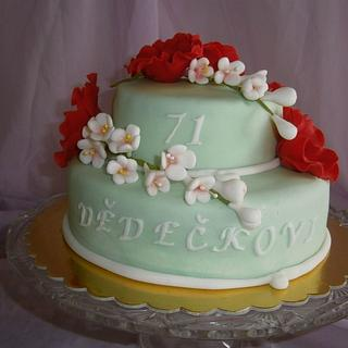 A cake with flowers of red weed