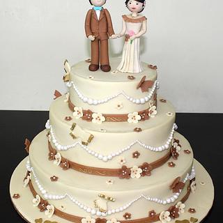 3 tier designer cake with edible couple topper for Wedding Reception