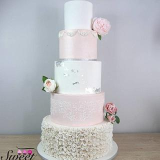 Blush and silver wedding cake