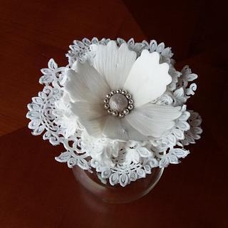 Sugar paste fantasy flower with sugar lace