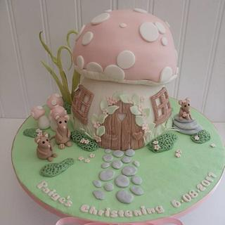 Toadstool cake with a family of mice