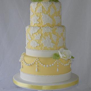 Yellow 3 tier cake with brush embroidery