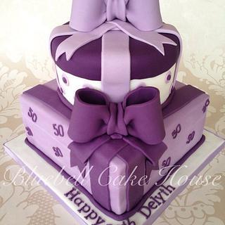Luxurious purple parcel two tier birthday cake