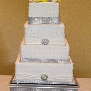 bling wedding cake with yellow hand made roses, diamante trimmings
