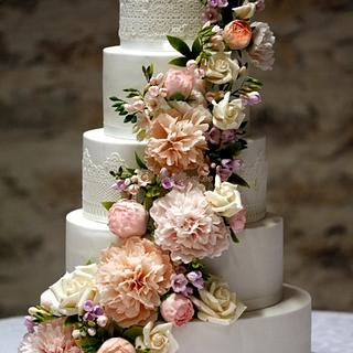 5 tiers wedding cake with peony, freesia and roses cascade
