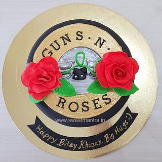 Guns and Roses theme customised fondant cake with 3D guns, roses for birthday