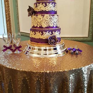 Purple and gold wedding cake