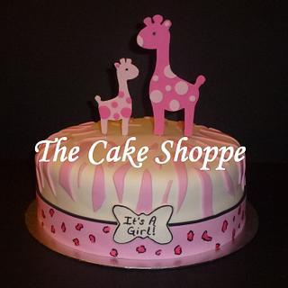 Pink giraffe baby shower cake