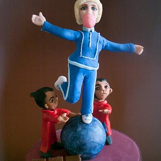 Violet balancing on a Blueberry - 50 Years of Charlie and the Chocolate Factory Collaboration