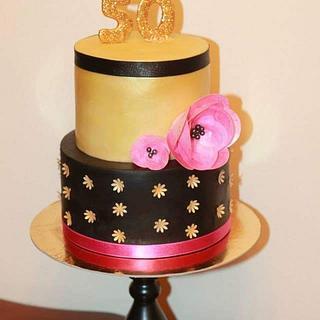 Gold and black 50th birthday cake..