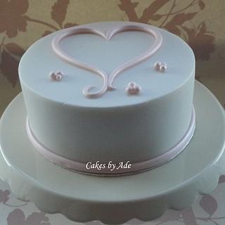 Simple lustre pink & white heart cake - February 2012
