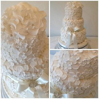 Three tier textured lace wedding cake