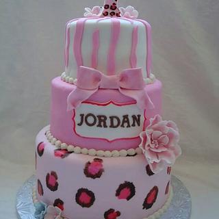 Animal print first birthday cake
