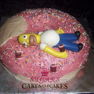 Donut-shaped cake with Homer simpsom