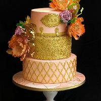Peach and gold wedding cake