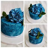 blue cake with hydrangea