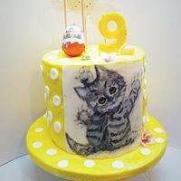 Birthday cake with hand-painted kitten