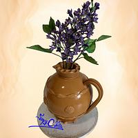 Romanian traditional pottery with lilac flower