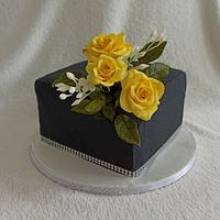 Black cake with roses
