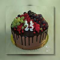 Chocolate birthday cake with fruits