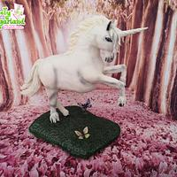 Unicorn gravity defying cake