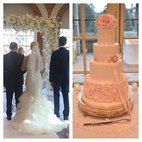 Pink ruffles and roses wedding cake  by Strawberry Lane Cake Company