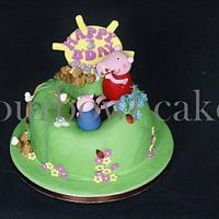 Peppa pig and George playing in a pool of mud and cupcakes