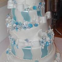 Winter wonderland themed wonky wedding cake by dazzleliciouscakes