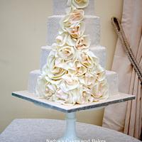 wedding dress cake with blush pink accents and pearls