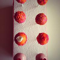 Orange and pink cake pops by SugaredSaffron