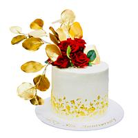 White and gold cake with red roses