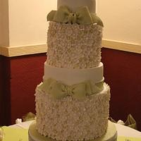 A 5 tier wedding cake (3 foot high) decorated with 800 sugar flowers and bows
