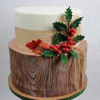 wooden cake with ilex decoration