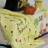 Sewing machine cake by designed by mani