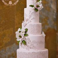 Sugar lace and magnolia wedding cake