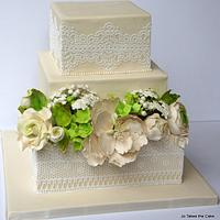 Flowers and lace wedding cake