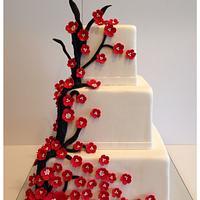 Red sugar blossom wedding cake